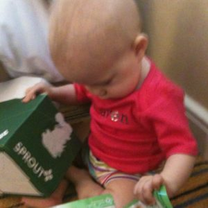 Quincy selects packages of Sprout Organic Baby Food for sampling.
