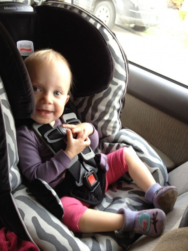 20 months and 18 pounds, happily rearfacing.
