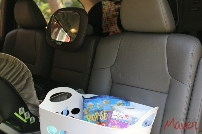 Throw your road trip snacks in a small laundry basket to keep them all in one place AD