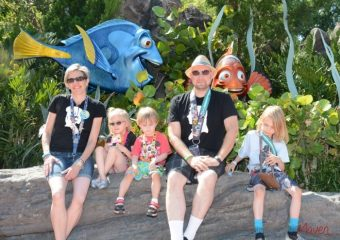 Family photo at Epcot. We're ALMOST all looking at the camera. YAY Autism and Disney
