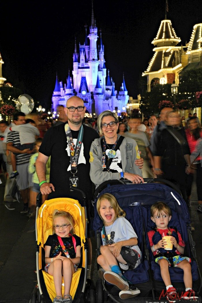 Our family in front of  Cinderella's castle at Walt Disney World at night.