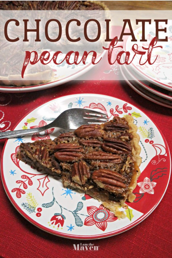 slice of chocolate pecan tart on a holiday plate