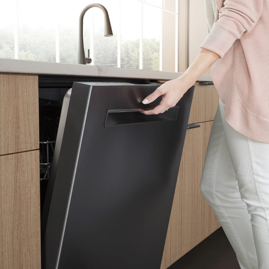 woman opening bosch dishwasher