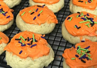 orange frosted halloween cookies with sprinkles