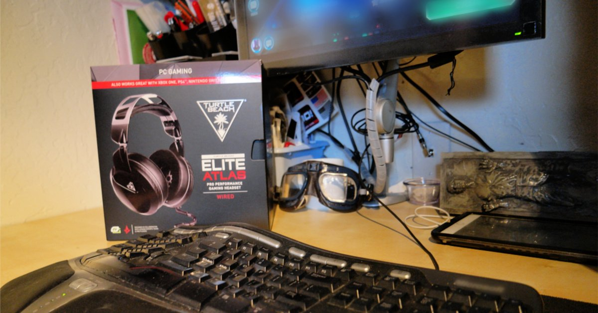 headset in box on desk with keyboard and monitor