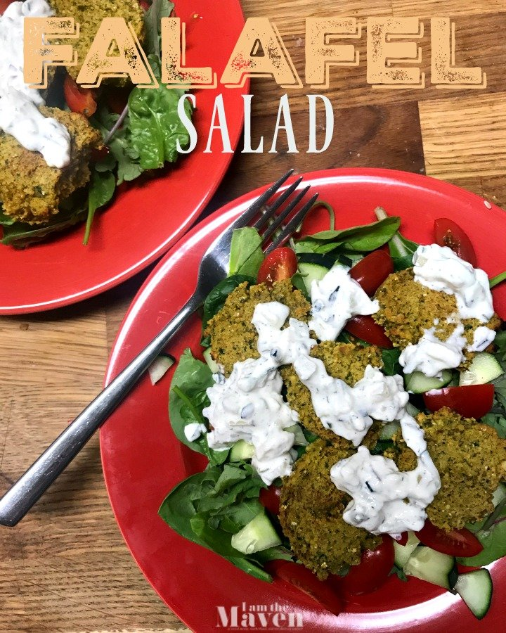 falafel salad with dressing on a red plate