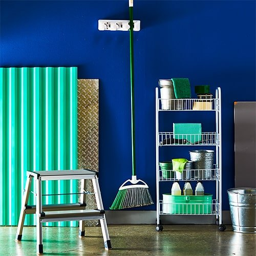 brightly colored furniture on a blue wall