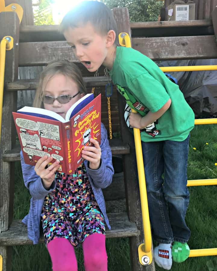 siblings looking at diary of awesome friendly kid book