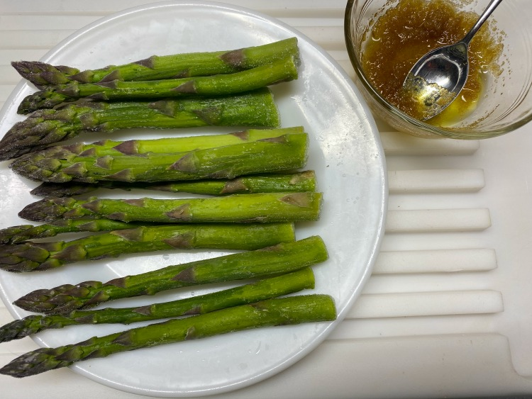 asparagus with bowl of sugar and oil