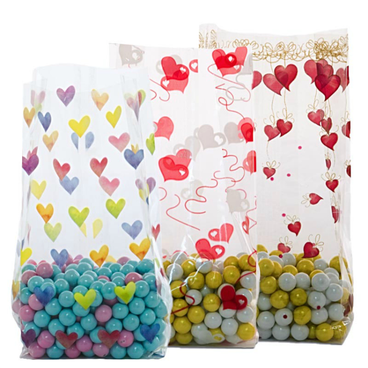 plastic bags with hearts on them, full of candy