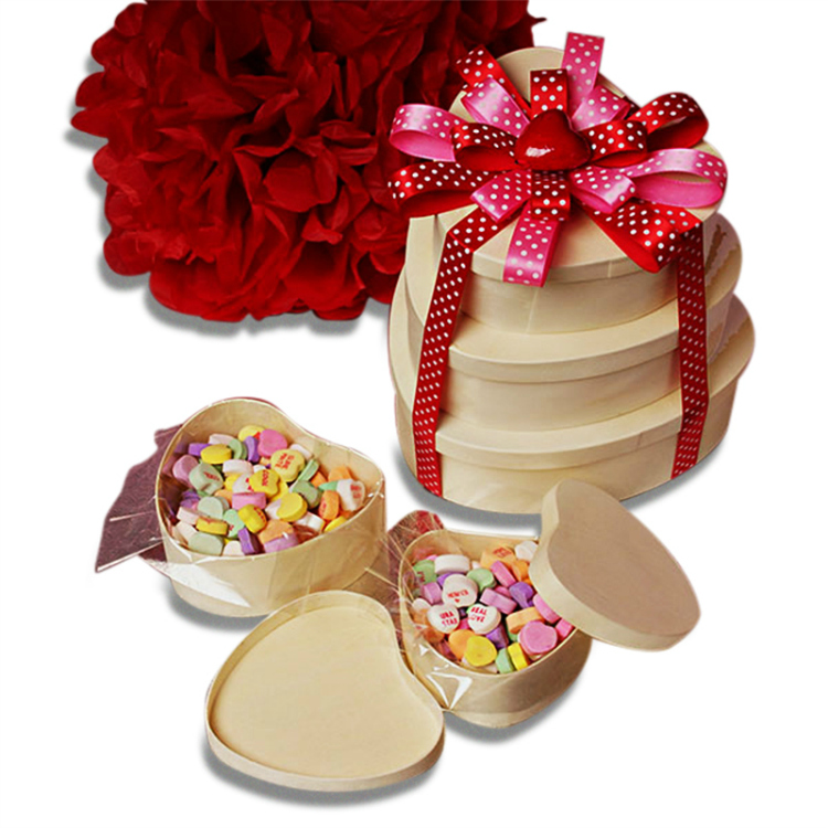wooden heart boxes with ribbon and candy