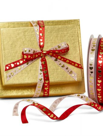 ribbon with hearts on it, tied on gold boxes