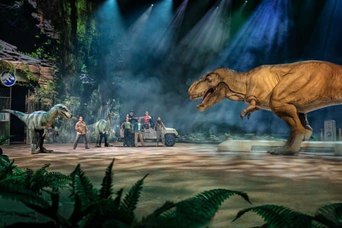 fake dinosaur roaring at people