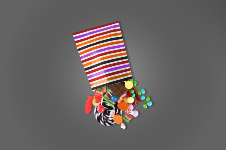 candy spilling out of treat bag