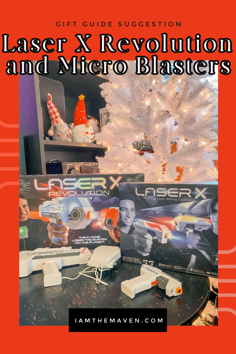 laser x blaster games on table next to white christmas tree