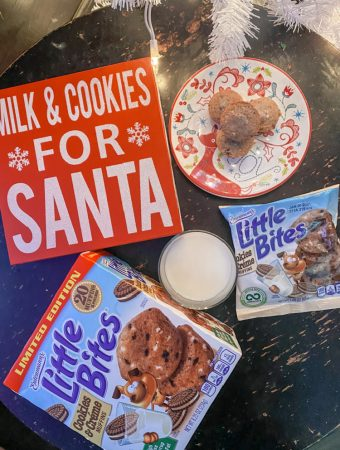 glass of milk, milk and cookies sign, muffins on a plate and little bites packaging