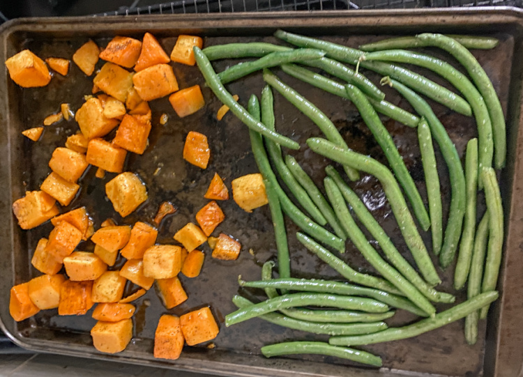 squash and green beans on a baking sheet