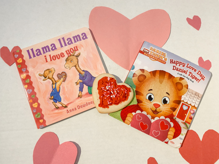 two childrens valentines day book on white background with hearts