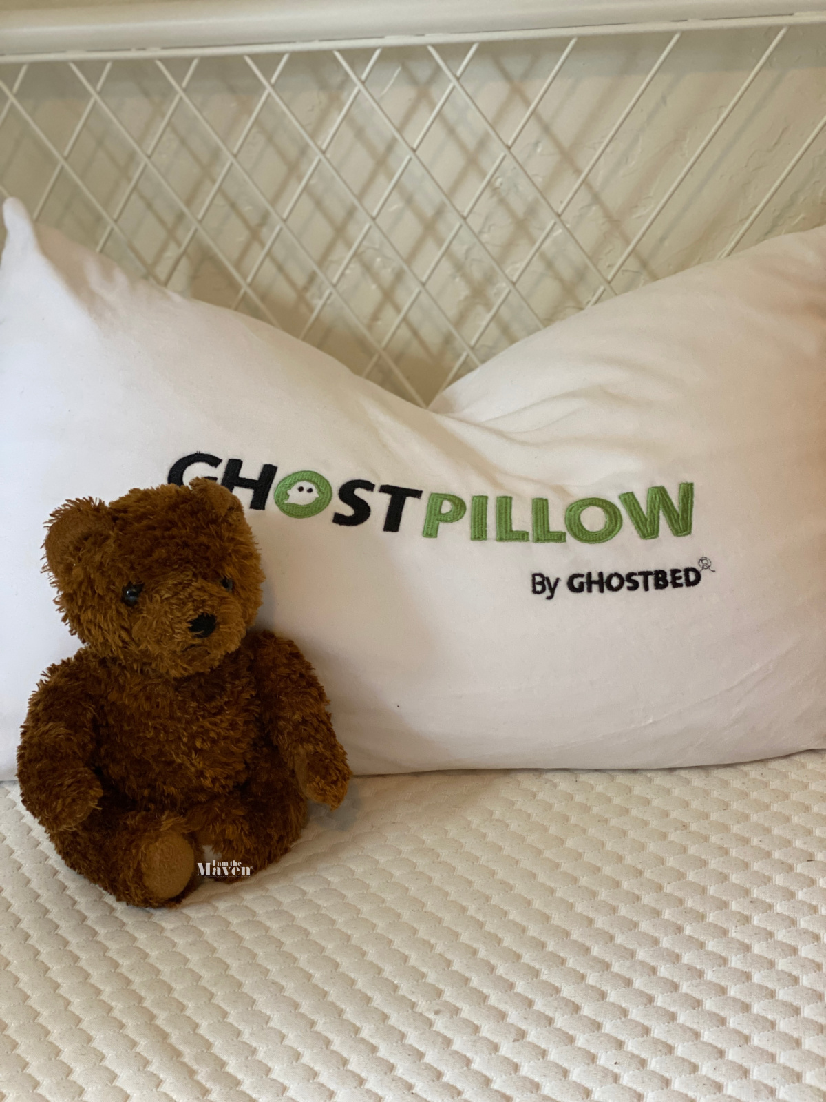 bear and pillow on bed